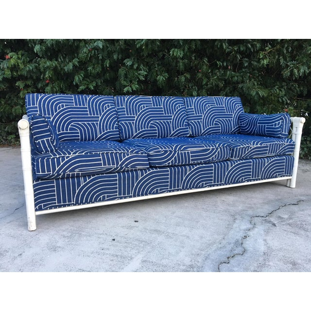 Beautiful rattan sofa features deep blue fabric with a modern print and woven rattan sides. Excellent condition with no...