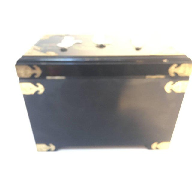 Large Chinese black lacquered jewelry box with mother-of-pearl figurines overlaid on hand-painted black lacquer, this...