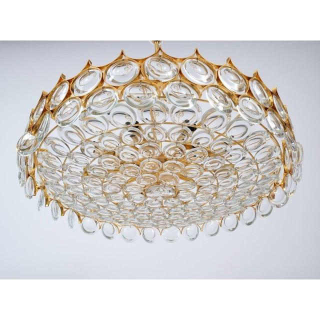 Refurbished Palwa gold brass and glass large chandelier ceiling lamp, 1960, Germany. Measuring 28 inch in diameter, this...