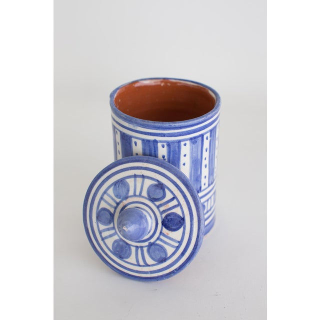 Hand painted cache pot from Morocco with lid, beautiful blue and white design with a raspberry interior. Fired to a high...