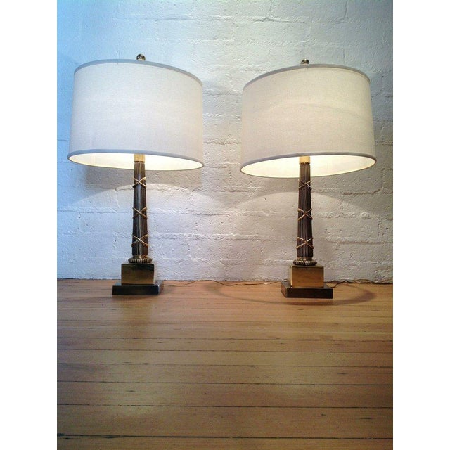 A pair of all brass Chapman table lamps.