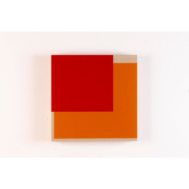 This contemporary abstract painting by American artist Brandon Woods features warm, vibrant fields of red and orange,...