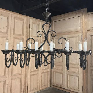Grand Antique Iron Chandelier Preview
