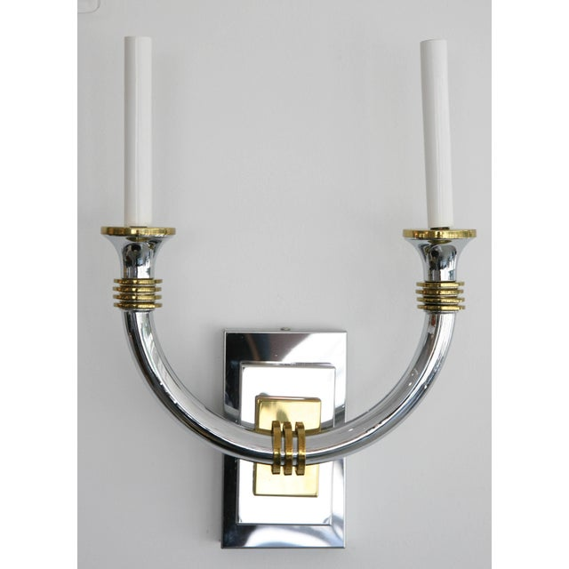 This stylish pair of wall sconces have taken the inspiration for the glamour of the Art Deco period. They are in polished...