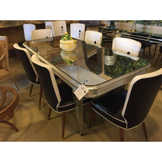 An antique mirrored Hollywood Regency decorative dining room table. This highly decorative dining table would bring...