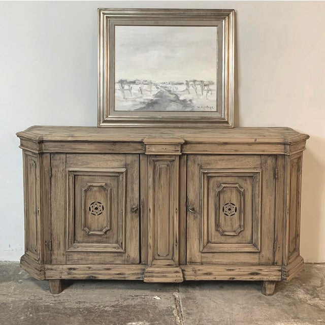 18th Century Stripped Pine Dutch Low Buffet exudes a rustic charm that calls to mind the talented rural artisan utilizing...