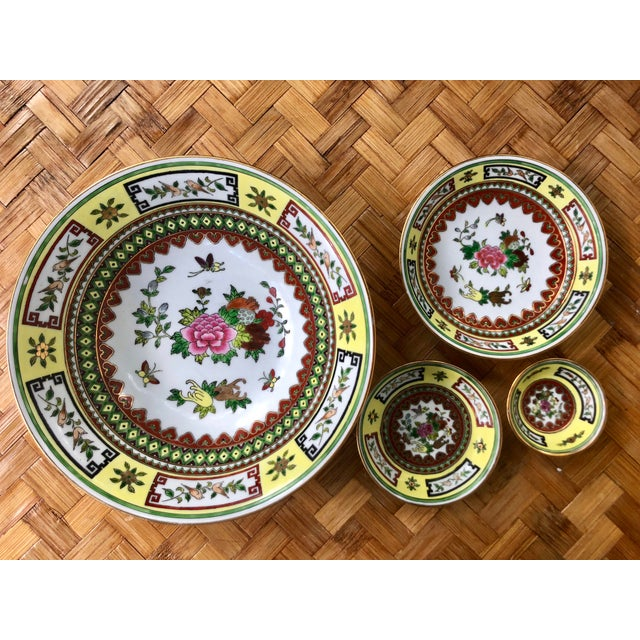 """Set of 4 Chinese stacking bowls. In """"Famille Jaune"""" or yellow family, featuring birds and intricate geometric and hand..."""