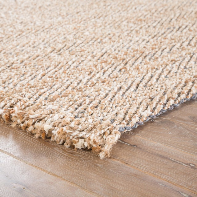 Boho style inspires the casual elegance of this natural area rug. This organic and sustainable jute layer showcases a chic...