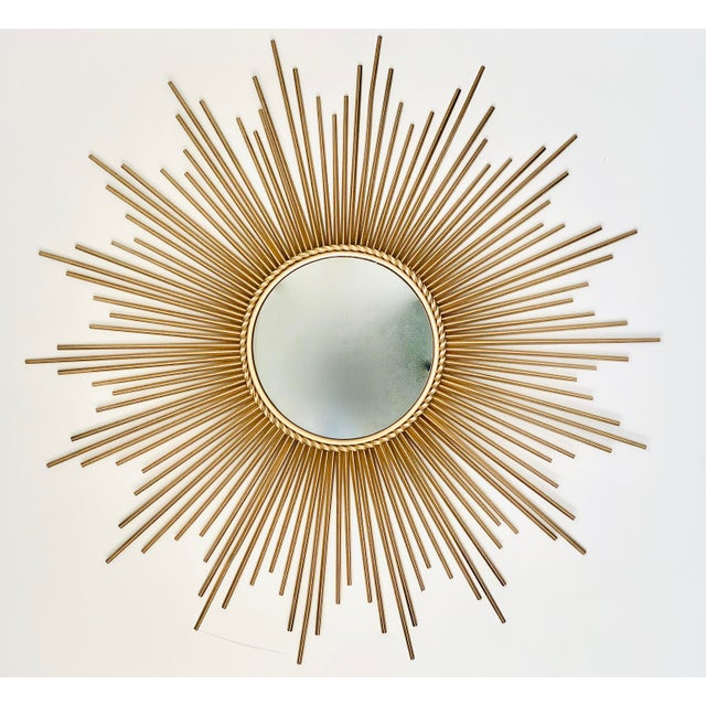 Mid-Century Modern convex sunburst mirror. The reflective surface measures 11.75''.