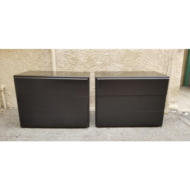 Pair of restored night stands in black lacquer. Designed by Milo Baughman