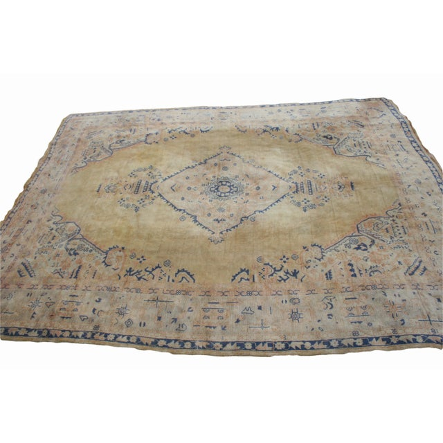 This rug features a soft yellow butter colored field with blue and bittersweet accents. The highly stylized border has an...