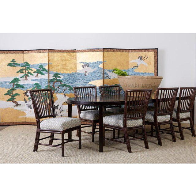 Spectacular 19th century Japanese Meiji six-panel screen depicting eight large red crowned cranes or Manchurian cranes on...