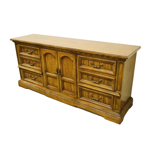 """Dixie Furniture Italian provincial 72"""" triple door dresser. We specialize in high end used furniture that we consider to..."""