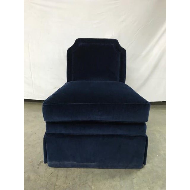 The Luc Skirted Swivel Chair is a first quality market sample that features a Navy Blue Fabric with an Ultra Down Seat...