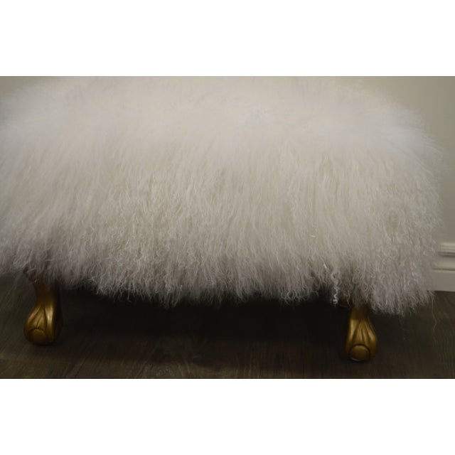 Custom made white curly lambs wool skin ottoman set on gilded legs. This ottoman is highly decorative, fun and fluffy....