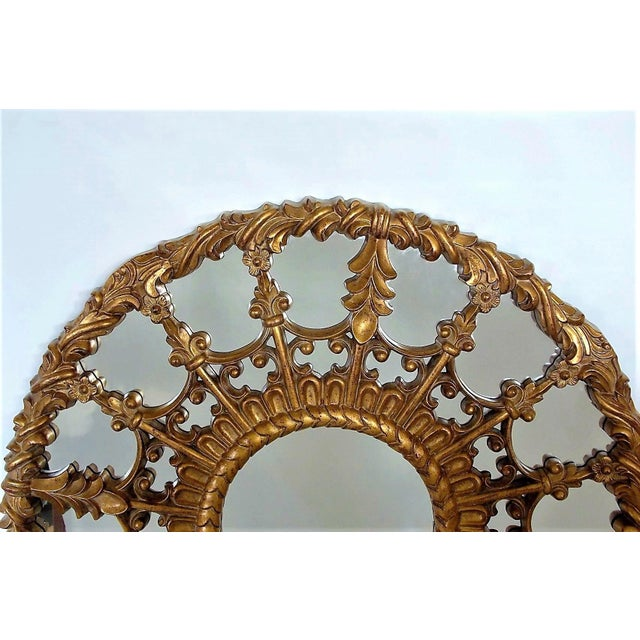 """Regency style round giltwood mirror with an intricate medallion design. Frame 1.75"""" W. No makers mark."""