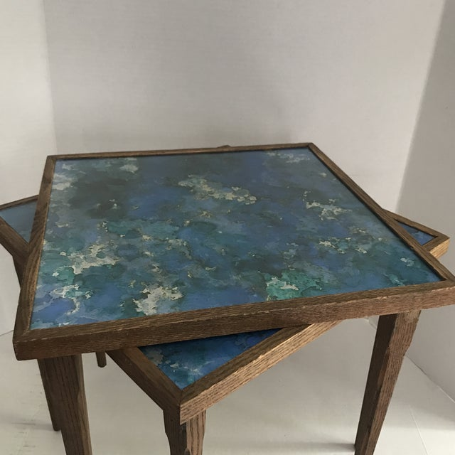 Brilliant blues, green and silver metallic paper under glass tops . These practical pieces are a feast for the eyes and...