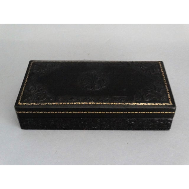 A vintage Italian embossed leather and gilt box with 2 complete decks of playing cards, pencil, and score sheet. This...