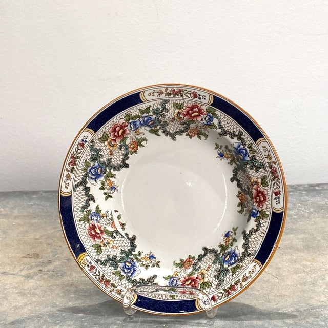 A set of 4 Cauldon soup plates, retailed by W. H. Plummer, New York