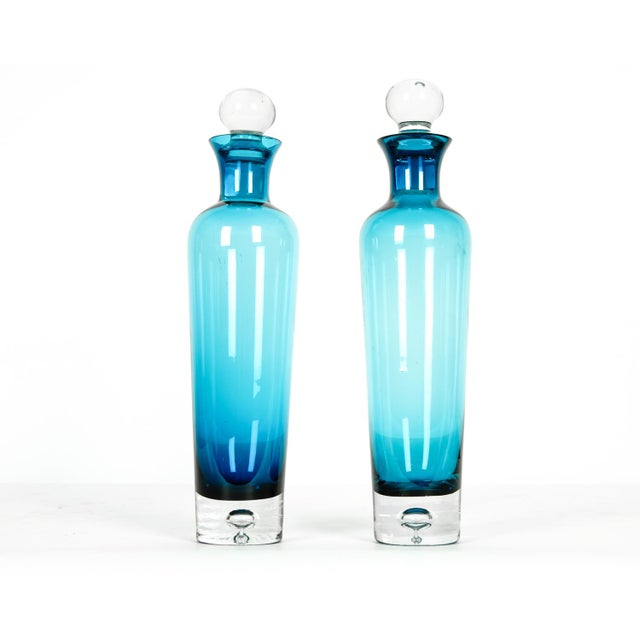 Mid century modern pair of turquoise crystal decanters. All in excellent condition. Each decanter measure 13 inches high X...