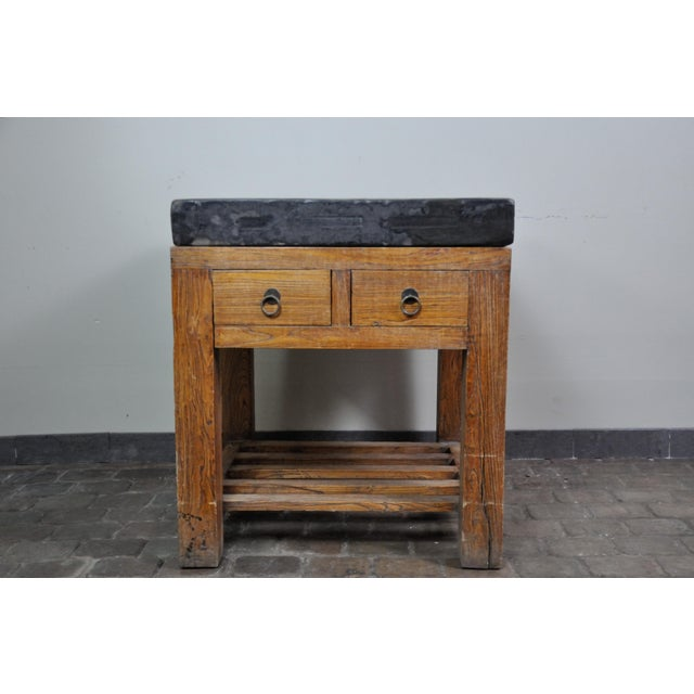 This table top has been around since the 1600s, this slab of hand-carved stone has a wonderfully earthy character in...