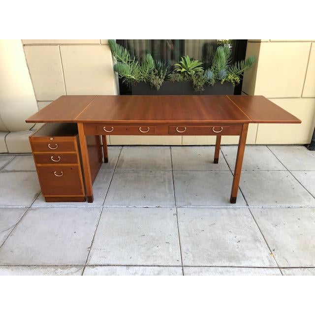 Extraordinary and rare mahogany mid century desk, designed by David Rosén and manufactured by Nordiska Kompaniet. Made in...