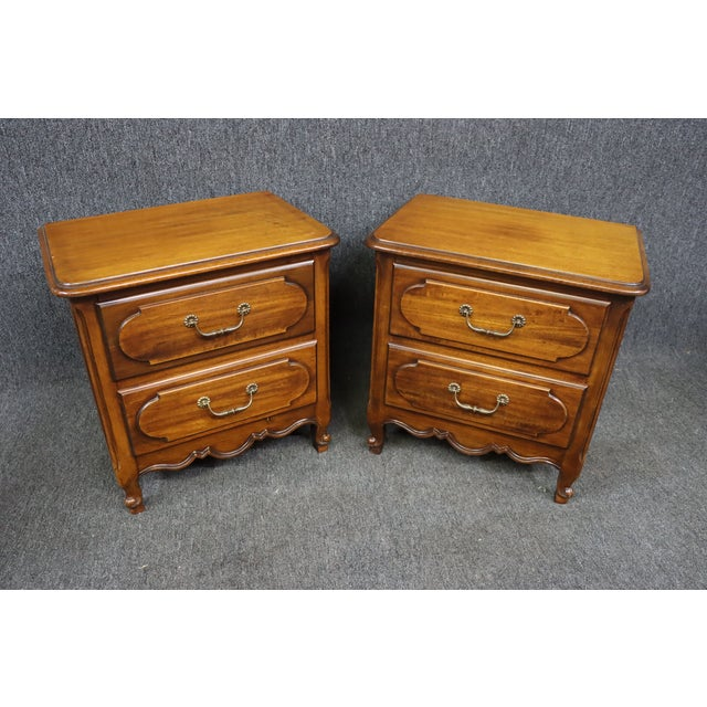 A pair of Louis XV style nightstands, made of Fruitwood, 2 drawers with raised panel fronts , scalloped panel sides,...