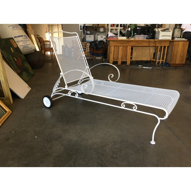 White painted iron outdoor / patio chaise lounge, produced in 1950 by the Woodard Furniture Company. This comfortable and...