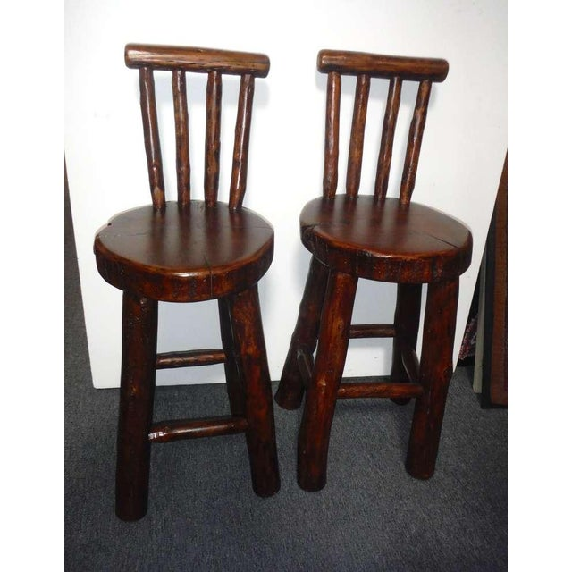 Amazing thick and heavy rustic hand made hickory bar stools with thick plank seats. This pair are in very good condition...