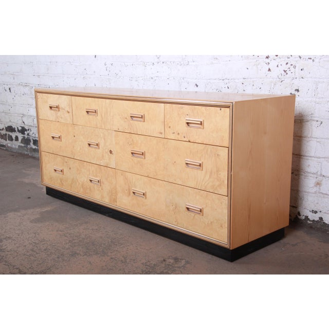 An exceptional Milo Baughman style burl wood long dresser or credenza from the Scene Two Collection by Henredon. The...