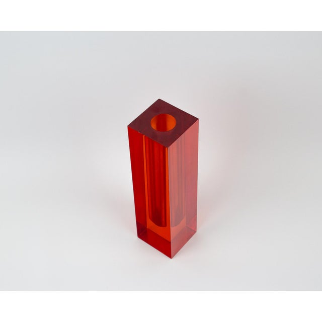Stunning vintage rectangular shaped lucite bud vase. Bright orange red color. Use to display single flower buds or as art...