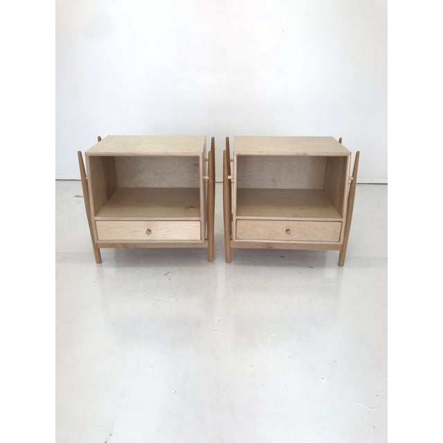 Amazing pair of exceptionally crafted nighstands . These feature wonderful maple grain , sculptural bases , and a clean...