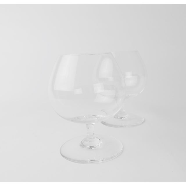 Set of two beautiful lightweight Baccarat crystal snifters for cognac and brandy. A lovely asset to your bar, to display...