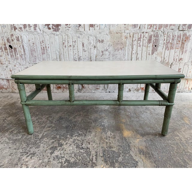 Mid-century rattan bamboo coffee table by Ficks Reed features a gorgeous green frame and a perfect amount of patina from...