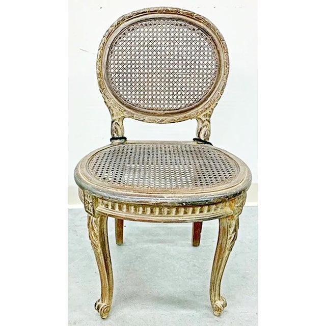 What a wonderful 19c French LouisVX-XVI transitional vanity chair, slightly worn original paint, roundback hand caning and...