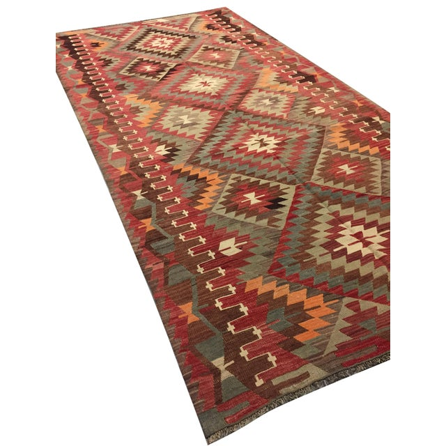 1940s Turkish handwoven kilim with geometric design. Color: brown/multi
