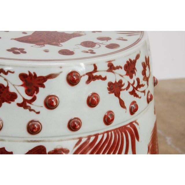 Stunning pair of Chinese ceramic garden stools or drink tables. Featuring a whimsical aquatic life motif with fish and sea...