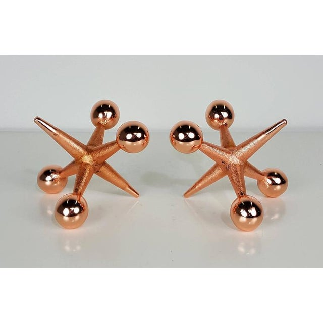 Classic Jacks Bookends or Paperweights in a custom Rose Gold Copper Finish.
