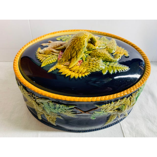 Offered is a large oval shaped English Majolica tureen dish with matching lid featuring dark cobalt blue glaze. This rare...