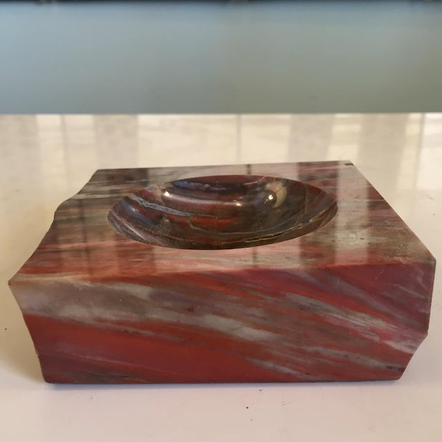 Polished petrified wood ashtray. Minor wear consistent with age.