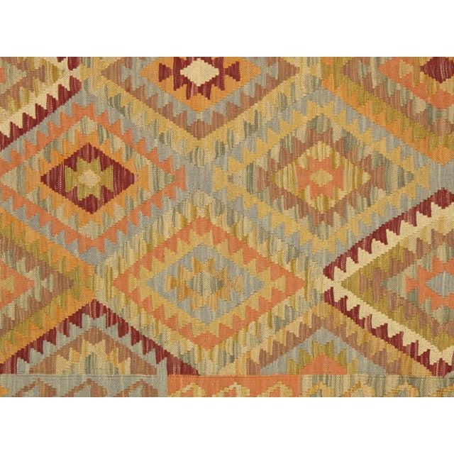 Vintage yellow/gold Anatolian flat-weave kilim rug is masterfully hand-knotted of top quality wool for enduring beauty. A...