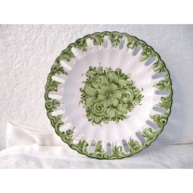 Lovely hand-painted vintage Portuguese pottery serving plate in a green floral motif with a pierced scalloped rim. Holes...