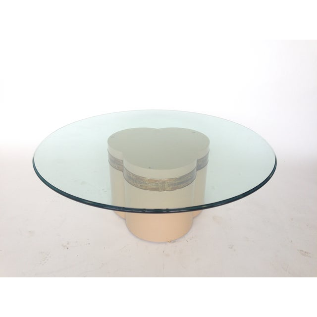 This stunning lacquered wood clover-form pedestal table is embellished with artist Bernhard Rohne's acid-etched brass...