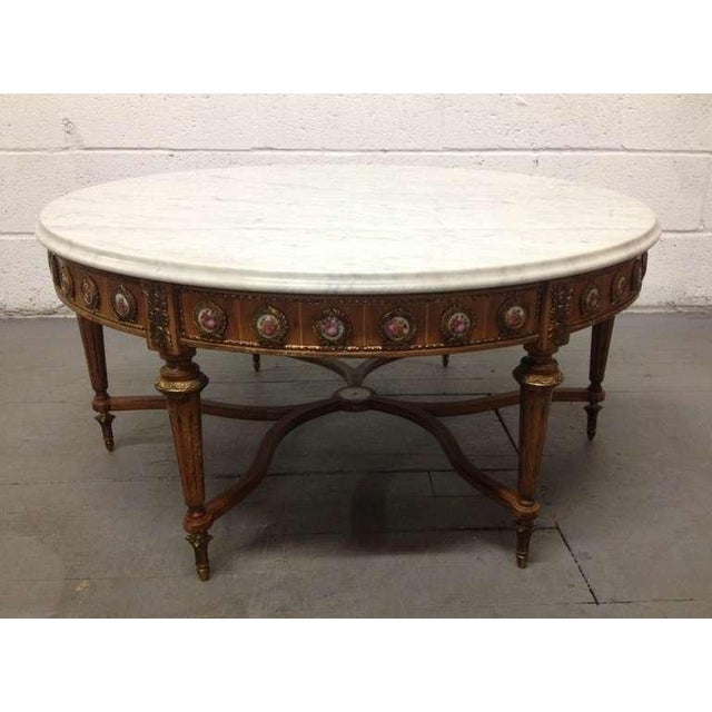 Late 19th century, French, Carrara marble top coffee table with a total of 36 porcelain sevres plaques. Has bronze mounts....