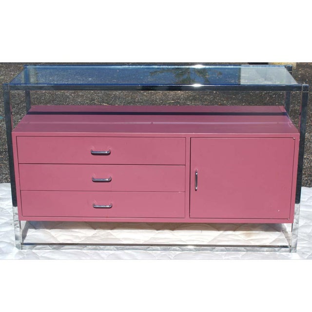 """50"""" Vintage Chrome Contour Bar Cabinet. Lacquered in pink and framed in chrome. 3 drawers and door cabinet with glass top..."""