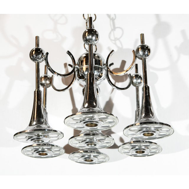Vintage Italian chandelier with seven clear Murano glasses and chrome metal frame, by Gaetano Sciolari. 7 lights / E14...