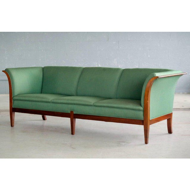 This elegant and generously sized three-seat sofa was designed and made by the Danish Master Cabinetmaker, Frits...