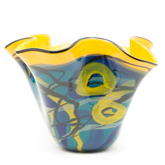 This vase is a vibrant red, yellow and blue work that was created by Ioan Nemtoi. The Artist-signed the vase. The vase has...