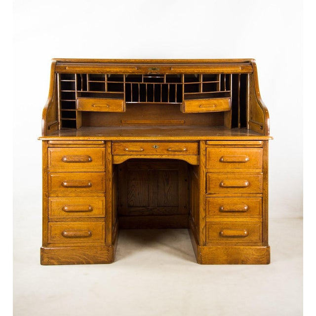 Bring some antique character to your study and work space with this American classic oak roll top writing desk. It has a...