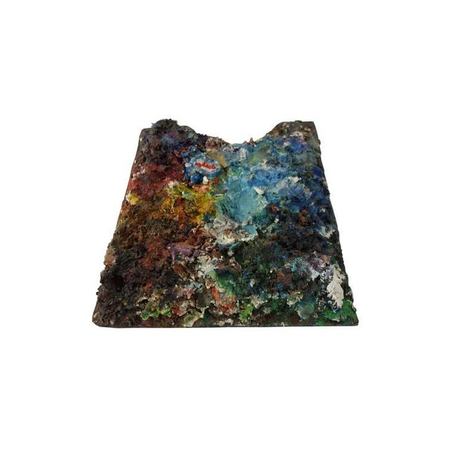 """This is a colorful artist's paint palette with years of paint build up giving it fantastic texture, circa 1970 signed """"Reno."""""""